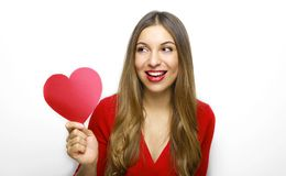 I`m waiting for you my love! Close up photo portrait of beautiful cheerful girl holding heart shaped paper. Valentine`s Day royalty free stock photography