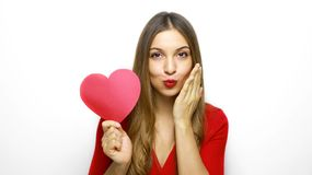 I`m waiting for you my love! Close up photo portrait of beautiful cheerful girl holding heart shaped paper. Valentine`s Day stock photography