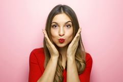 I`m waiting for your kiss! Close up portrait of excited beautiful cheerful joyful woman wants to kiss you isolated on pink stock photos