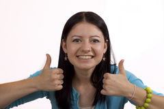 I made it!. Happy young woman on white background with both thumbe up stock photo