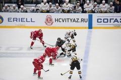 I. Magogin 48 and M. Aaltonen 55 on faceoff. PODOLSK, RUSSIA - NOVEMBER 13, 2016: I. Magogin 48 and M. Aaltonen 55 on faceoff on hockey game Vityaz vs Severstal Stock Photos