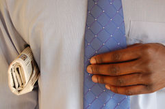 I mean business. This is an image of a black business man with a newspaper under his arm stock photos