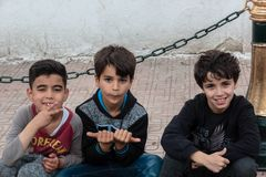 Three algerian boys smiling at me royalty free stock photography