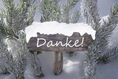 I mezzi di Danke dell'albero di abete della neve del segno di Natale vi ringraziano Immagini Stock