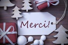 I mezzi di Merci dell'albero del regalo dell'etichetta di Natale vi ringraziano Fotografia Stock