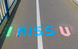 I miss u. Text painted on the street Stock Photography