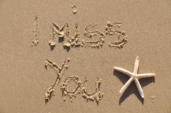 I miss you. Written in the sand with a starfish Stock Images