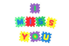 I Miss You. Message I miss you from letter puzzle, isolated on white Stock Images