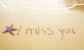 I Miss You. Written in Sand on Beach with a sea star Royalty Free Stock Images
