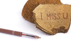 I miss you.Closeup. I miss you is written on a coconut shell.Closeup Stock Image