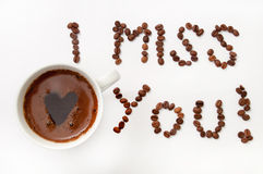 I miss you sign with coffee beans and cup of coffee.  Royalty Free Stock Photos
