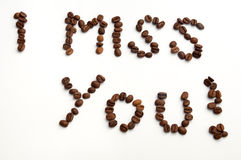 I miss you sign with coffee beans over white background Stock Photography