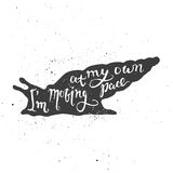 I am moving at my own pace lettering in snail. Lettering composition. Phrase I am moving at my own pace inscribed into snail silhouette. Ink splashes on white Stock Photo