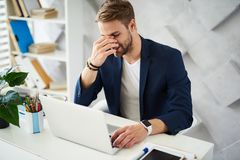 Tired man working in office royalty free stock photography