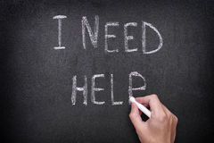I Need Help. Hand drawing I Need Help on blackboard. Vignette. Close up Royalty Free Stock Images