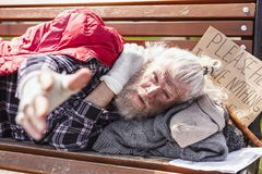 Unhappy poor man looking at you. I need help. Unhappy poor man looking at you while needing social help royalty free stock image