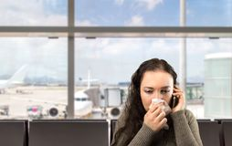I need medical assistance. Sick woman calling doctor urgently at the airport Stock Photography