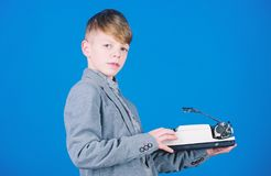 I need modern gadget instead this retro. Outdated gadget. Retro and vintage. Yard sale. Retrospective study. Boy hold. Retro typewriter on blue background. What royalty free stock photography