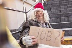Serious poor man needing a job. I need money. Serious poor man needing a job while having no money stock image