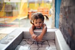 I need a refresh. Little girl playing with water. Close up. Copy space royalty free stock image