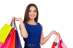 I need some retail therapy. Attractive young woman holding shopping bags and smiling at camera Royalty Free Stock Photos