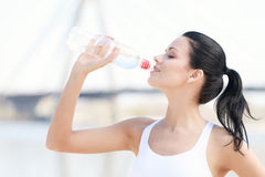 I need some water after training. Portrait of beautiful young wo Stock Photography