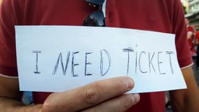 I need ticket inscription, male looking for illegal resale outdoors, counterfeit. Stock photo stock image