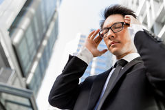 I need to concentrate. Businessman standing in street and trying to concentrate Royalty Free Stock Photography
