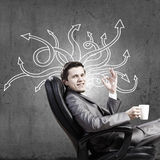 I need to find answer. Young pensive businessman and thoughts coming out of his head Stock Photo