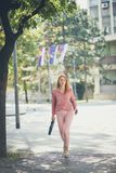 I need to speed up the step to arrive on time. Business woman walking trough street stock photo