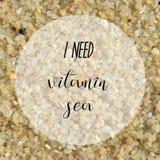 I need vitamin sea on gravel background. I need vitamin sea. Inspirational quote on gravel background Stock Photography