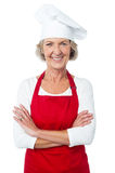 I am the new chef here. Confident aged woman chef smiling over white Stock Photos