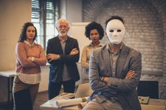I am new here. Business people at the office. Person with mask on face royalty free stock photography
