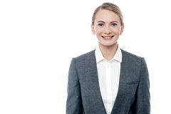 I am the new manager here. Portrait of a young businesswoman posing over white Stock Photos
