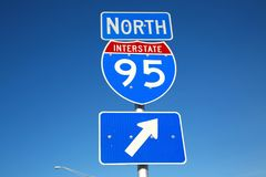 I-95 North Sign Against Clear Blue Sky. An Interstate 95 North sign with an arrow indicates which way to go to the on-ramp in a sunny afternoon against a clear royalty free stock photos