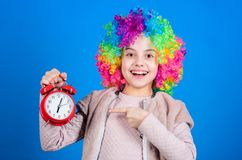 I am not joking about discipline. False alarm. Girl worry about time. Time to have fun. Discipline and time concept. Circus performance timing. Kid colorful royalty free stock image