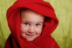I am not from Taliban. 2 year old smiling child in a red scarf Royalty Free Stock Image