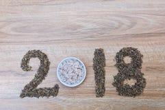 I numeri di 2018 buoni anni con riso su di legno Immagini Stock Libere da Diritti