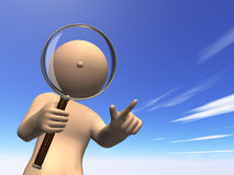 I observe something with magnifying glass. Stock Photography