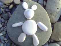 I ours blanc du ` m Ours fait de cailloux de plage images stock