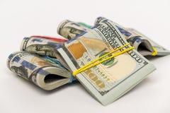 I pacchetti di cento banconote in dollari immagine stock libera da diritti