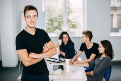 Business man with colleagues meeting behind him stock images
