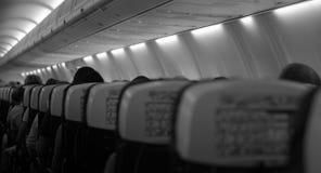 I passeggeri sono chiesti di prendere i sedili e fissare le loro cinture di sicurezza Fotografia Stock Libera da Diritti