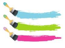 I pennelli con colore spruzza Fotografie Stock Libere da Diritti
