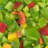I peperoni dolci tagliati vicino osservano Immagine Stock