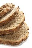 I pezzi di grano impanano isolato su fondo bianco fotografie stock libere da diritti