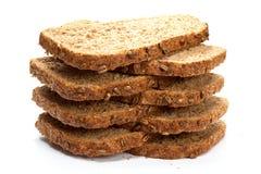 I pezzi di grano impanano isolato su fondo bianco Fotografia Stock Libera da Diritti