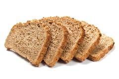 I pezzi di grano impanano isolato su fondo bianco Immagine Stock