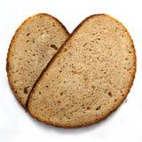 I pezzi di grano impanano isolato su fondo bianco fotografia stock