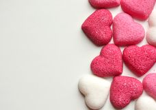 I pezzi di zucchero con cuore modella su fondo bianco Fotografie Stock Libere da Diritti